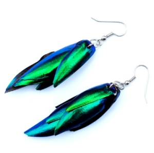 'Beetle-wing' earrings. Traditionally made in Thailand their wings were valued for their beautiful and hardy metallic emerald iridescence. The shiny appearance of beetle wings is long lasting. Available at Pebble London.